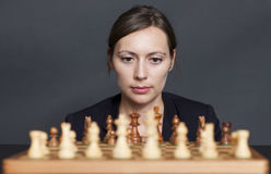 Business woman over a chess game Royalty Free Stock Photography