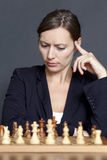 Business woman over a chess game Stock Photo