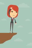 Business woman over the gorge. Business woman standing over the gorge at a loss, vector illustration Royalty Free Stock Image