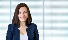Business woman.  over jalousie Royalty Free Stock Photo