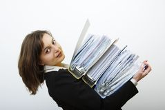 Business woman overloaded with heavy files. Young attractive business woman overloaded with heavy files Royalty Free Stock Photos