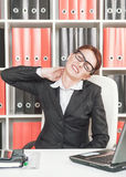 Business woman with pain in her neck Royalty Free Stock Image