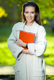 Business woman with paper folder Royalty Free Stock Image