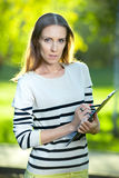 Business woman with paper folder. Student Stock Images