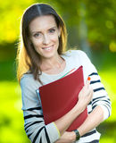 Business woman with paper folder. Student Royalty Free Stock Images