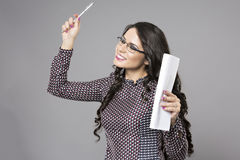 Business woman with a paper in hand. Isolated on gray background Royalty Free Stock Images
