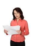 The business woman with papers. Business of lady transfers documents and closely looks. A white background Royalty Free Stock Photography