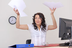 Business woman with papers flying up stock photos