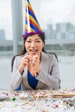 Business woman in a party hat Royalty Free Stock Photography