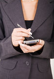 Business woman with PDA Stock Image