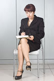 The business woman with a pen  Stock Photography
