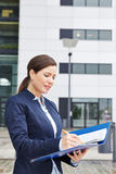 Business woman with pen and files Royalty Free Stock Photos