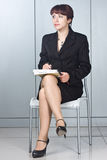 The business woman with a pen in hands Stock Images