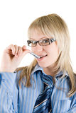 Business woman with pen at mouth Royalty Free Stock Image