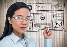Business woman with pen and website mock up against blurry wood panel Stock Photos