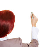 Business woman with pen writing Royalty Free Stock Photos
