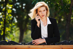 Fashion business woman calling on cell phone Stock Image