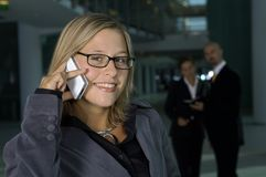 Business woman on the phone. Young business woman talking on the phone Stock Image