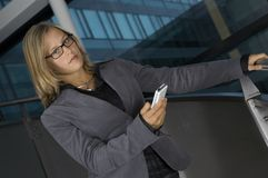 Business woman with the phone. Young business woman with phone in her hand Stock Photography