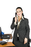 Business woman with phone. Serious  business woman on the phone at office,more photos with this model in Business people ,laptop and money Royalty Free Stock Photos