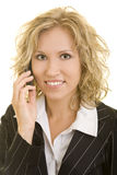 Business woman on the phone. Blonde business woman using her cell phone royalty free stock images