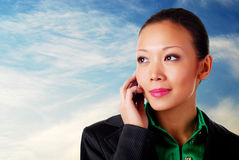 Business woman with phone Royalty Free Stock Photography