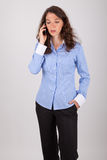 The business woman is on the phone with her mobile phone Royalty Free Stock Photo