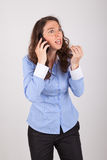 The business woman is on the phone with her mobile phone Royalty Free Stock Image