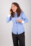 The business woman is on the phone with her mobile phone Royalty Free Stock Images