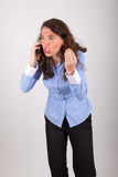 The business woman is on the phone with her mobile phone Stock Image