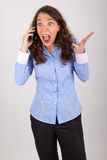 The business woman is on the phone with her mobile phone Stock Images