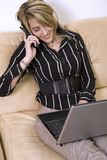 Business woman on the phone and laptop Stock Images