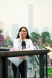 Business woman on the phone in modern environment Royalty Free Stock Photo