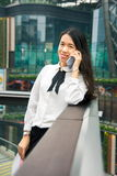 Business woman on the phone in modern environment. Outside royalty free stock photos