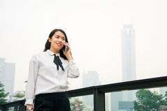 Business woman on the phone in modern environment. Outside stock photo