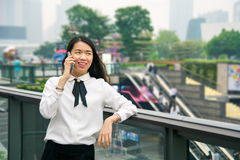 Business woman on the phone in modern environment. Outside stock photos