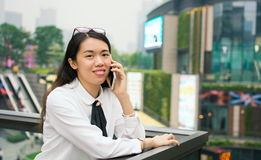 Business woman on the phone in modern environment. Outside stock image