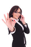 Business woman on phone, ok sign Royalty Free Stock Images
