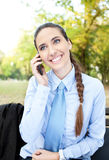 Business woman on phone in park Stock Photography