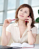 Business woman on phone taking notes Stock Image