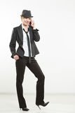 Business woman phone talk. girl posing in suit and hat. Royalty Free Stock Photo