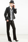 Business woman phone talk. girl posing in suit and hat. Royalty Free Stock Photos