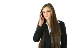Business Woman on Phone. Business woman talking on the phone looking straight Royalty Free Stock Image