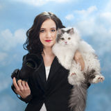 Business woman photographer and her cat on Stock Image