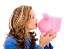 Business woman and a piggy bank Royalty Free Stock Photo