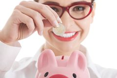Business woman with piggy-bank Stock Images