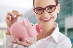 Business woman with piggy-bank Stock Image