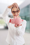 Business woman with piggy-bank Royalty Free Stock Photography