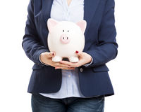 Business woman with a piggy bank Royalty Free Stock Photo