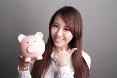 Business woman with piggy bank Stock Photos